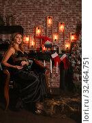 Купить «Beautiful woman in a loft apartment», фото № 32464751, снято 17 ноября 2019 г. (c) Art Konovalov / Фотобанк Лори