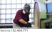 Carpenter handles wooden block on grinding machine. Стоковое видео, видеограф Яков Филимонов / Фотобанк Лори