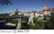 Купить «Devils bridge with cathedral at the background. Cividale del Friuli. Italy», видеоролик № 32464779, снято 3 сентября 2019 г. (c) Яков Филимонов / Фотобанк Лори