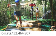Купить «Obstacle course over the water - fun adventure in an amusement park», видеоролик № 32464807, снято 29 июня 2020 г. (c) Яков Филимонов / Фотобанк Лори