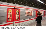 Купить «Inside view of Hradcanska Metro station with underground carriage in Prague», видеоролик № 32472099, снято 13 октября 2019 г. (c) Яков Филимонов / Фотобанк Лори