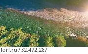 Купить «Low altitude flight over fresh fast mountain river with rocks at sunny summer morning.», видеоролик № 32472287, снято 4 апреля 2019 г. (c) Александр Маркин / Фотобанк Лори