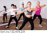 Купить «Ordinary active females exercising dance moves», фото № 32474231, снято 21 сентября 2019 г. (c) Яков Филимонов / Фотобанк Лори
