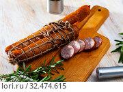 Купить «Sliced half-smoked sausages on wooden table», фото № 32474615, снято 29 февраля 2020 г. (c) Яков Филимонов / Фотобанк Лори