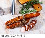 Купить «Lean smoked ham sausage on wooden table», фото № 32474619, снято 11 декабря 2019 г. (c) Яков Филимонов / Фотобанк Лори