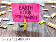 Купить «Writing note showing Earth Hour 25Th March. Business photo showcasing symbol commitment to planet Organized World Wide Fund Multiple clips woody table small card clipped notice announcement», фото № 32480947, снято 12 июля 2020 г. (c) easy Fotostock / Фотобанк Лори