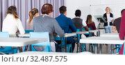 Купить «Students with teacher studying in classroom», фото № 32487575, снято 8 мая 2018 г. (c) Яков Филимонов / Фотобанк Лори
