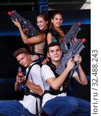 Купить «Young people posing with laser pistols», фото № 32488243, снято 27 августа 2018 г. (c) Яков Филимонов / Фотобанк Лори