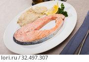 Купить «Pan seared salmon with hummus», фото № 32497307, снято 14 декабря 2019 г. (c) Яков Филимонов / Фотобанк Лори