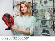Купить «Salesgirl offering necklaces of precious corals», фото № 32500591, снято 7 декабря 2019 г. (c) Яков Филимонов / Фотобанк Лори