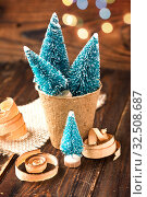 Купить «Artificial little Christmas treees in biodegradable peat moss and wooden shavings. Eco-friendly New Year and Christmas», фото № 32508687, снято 26 ноября 2019 г. (c) Papoyan Irina / Фотобанк Лори