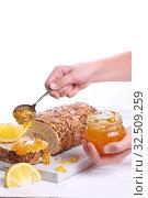 Купить «Children's hands pour jam on a piece of biscuit roll», фото № 32509259, снято 27 ноября 2019 г. (c) Марина Володько / Фотобанк Лори