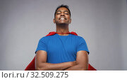 Купить «happy smiling indian man in red superhero cape», видеоролик № 32509275, снято 26 ноября 2019 г. (c) Syda Productions / Фотобанк Лори