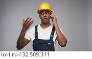Купить «indian builder in helmet calling on smartphone», видеоролик № 32509311, снято 26 ноября 2019 г. (c) Syda Productions / Фотобанк Лори