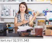 Купить «Glad woman seller working with documents», фото № 32511343, снято 7 мая 2018 г. (c) Яков Филимонов / Фотобанк Лори