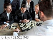 Business people playing chess, team of workers losing, leader is winning. Стоковое фото, фотограф Zoonar.com/Tatiana Badaeva / easy Fotostock / Фотобанк Лори