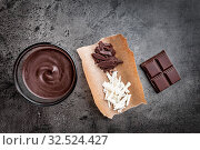 Variety of delicious chocolate on wooden background. Стоковое фото, фотограф Zoonar.com/Tomas Anderson / easy Fotostock / Фотобанк Лори