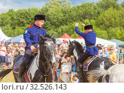 Купить «Russia, Samara, July 2019: Cossacks perform tricks on a galloping horse.», фото № 32526143, снято 28 июля 2019 г. (c) Акиньшин Владимир / Фотобанк Лори