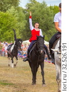 Купить «Russia, Samara, July 2019: Cossacks perform tricks on a galloping horse.», фото № 32526191, снято 28 июля 2019 г. (c) Акиньшин Владимир / Фотобанк Лори