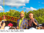Купить «Russia, Samara, July 2019: an ethno-historical holiday with a reconstruction of the battle of Timur and Tokhtamysh in 1391. Joint photo with the festival khan participant.», фото № 32526355, снято 28 июля 2019 г. (c) Акиньшин Владимир / Фотобанк Лори