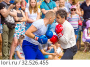 Купить «Russia, Samara, July 2019: an ethno-historical holiday with a reconstruction of the battle of Timur and Tokhtamysh in 1391. Stenosh fight. Competition men wall to wall. Fist fights.», фото № 32526455, снято 28 июля 2019 г. (c) Акиньшин Владимир / Фотобанк Лори