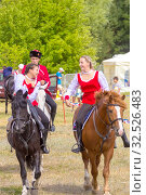 Купить «Russia, Samara, July 2019: Cossacks perform tricks on a galloping horse.», фото № 32526483, снято 28 июля 2019 г. (c) Акиньшин Владимир / Фотобанк Лори