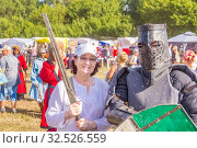 Купить «Russia, Samara, July 2019: an ethno-historical holiday with a reconstruction of the battle of Timur and Tokhtamysh in 1391. Joint photo with the participant of the festival. Warrior in the armor.», фото № 32526559, снято 28 июля 2019 г. (c) Акиньшин Владимир / Фотобанк Лори