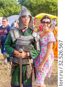 Купить «Russia, Samara, July 2019: an ethno-historical holiday with a reconstruction of the battle of Timur and Tokhtamysh in 1391. Joint photo with the participant of the festival. Warrior in the armor.», фото № 32526567, снято 28 июля 2019 г. (c) Акиньшин Владимир / Фотобанк Лори