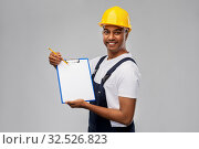 Купить «happy builder in helmet with clipboard and pencil», фото № 32526823, снято 17 ноября 2019 г. (c) Syda Productions / Фотобанк Лори