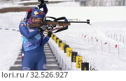 Russian sportswomans biathlete aiming, rifle shooting and reloading in standing position. Biathlete shooting range during Junior biathlon competitions East Cup (2019 год). Редакционное видео, видеограф А. А. Пирагис / Фотобанк Лори