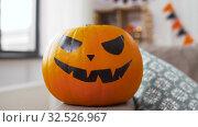Купить «jack-o-lantern pumpkin at home on halloween», видеоролик № 32526967, снято 14 ноября 2019 г. (c) Syda Productions / Фотобанк Лори
