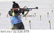 Купить «Sportswoman biathlete aiming, rifle shooting, reloading standing position. South Korea biathlete Lee Hyunju in shooting range. Junior biathlon competitions East Cup», видеоролик № 32526979, снято 13 апреля 2019 г. (c) А. А. Пирагис / Фотобанк Лори
