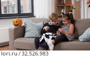 kids in halloween costumes with tablet pc at home. Стоковое видео, видеограф Syda Productions / Фотобанк Лори