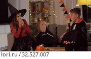 Купить «kids in halloween costumes playing at home», видеоролик № 32527007, снято 14 ноября 2019 г. (c) Syda Productions / Фотобанк Лори
