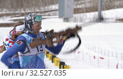 Sportswoman biathlete aiming, rifle shooting standing position. Biathlete Arina Soldatova in shooting range. Regional junior biathlon competitions East Cup (2019 год). Редакционное видео, видеограф А. А. Пирагис / Фотобанк Лори
