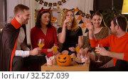 Купить «happy friends in halloween costumes at home party», видеоролик № 32527039, снято 18 ноября 2019 г. (c) Syda Productions / Фотобанк Лори