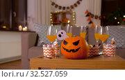 Купить «halloween decorations and treats on table at home», видеоролик № 32527059, снято 18 ноября 2019 г. (c) Syda Productions / Фотобанк Лори