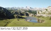 Купить «Aerial view of Picturesque summer landscape of highland Lakes of Covadonga within Picos de Europa National Park», видеоролик № 32527359, снято 15 июля 2019 г. (c) Яков Филимонов / Фотобанк Лори