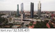 Купить «Aerial view of four Towers Business Area (Cuatro Torres) in Madrid, Spain», видеоролик № 32535431, снято 16 июня 2019 г. (c) Яков Филимонов / Фотобанк Лори