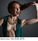Купить «Erotica. Screaming model advertises jewelry», фото № 32535475, снято 20 июня 2016 г. (c) Гурьянов Андрей / Фотобанк Лори