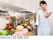 Купить «Upset woman checking food», фото № 32536123, снято 5 сентября 2017 г. (c) Яков Филимонов / Фотобанк Лори