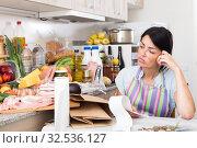 Купить «Female is upset of check on food», фото № 32536127, снято 5 сентября 2017 г. (c) Яков Филимонов / Фотобанк Лори