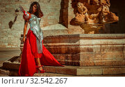 Купить «Medieval, Beautiful brunette woman wearing gold and copper corset in goddess and warrior poses. fantasy and imagination concept», фото № 32542267, снято 13 июля 2020 г. (c) easy Fotostock / Фотобанк Лори