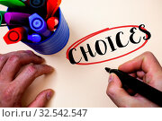 Купить «Conceptual hand writing showing Choices. Business photo text Preference Discretion Inclination Distinguish Options Selection Man holding black marker markers table ideas message communicate», фото № 32542547, снято 25 мая 2020 г. (c) easy Fotostock / Фотобанк Лори