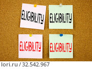 Conceptual hand writing text caption inspiration showing Eligibility Business concept for Suitable Eligible Eligibility on colourful Sticky Note close-up. Стоковое фото, фотограф Zoonar.com/Artur Szczybylo / easy Fotostock / Фотобанк Лори