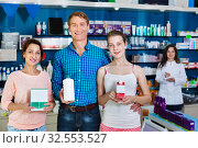 Купить «Smiling parents with girl teenager holding drug store goods», фото № 32553527, снято 24 февраля 2020 г. (c) Яков Филимонов / Фотобанк Лори