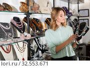 Купить «Female client choosing pearl necklace», фото № 32553671, снято 7 декабря 2019 г. (c) Яков Филимонов / Фотобанк Лори