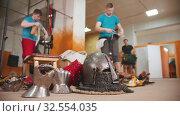 Купить «Men knights training in the gym - equipment for the knights battle lying on the floor», видеоролик № 32554035, снято 27 мая 2020 г. (c) Константин Шишкин / Фотобанк Лори