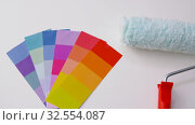 paint roller and color palette on white background. Стоковое видео, видеограф Syda Productions / Фотобанк Лори