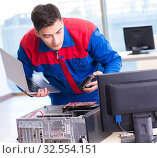 Купить «Computer repairman specialist repairing computer desktop», фото № 32554151, снято 19 января 2018 г. (c) Elnur / Фотобанк Лори
